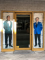 Stanley Diamond restaurant entrance with men in suits
